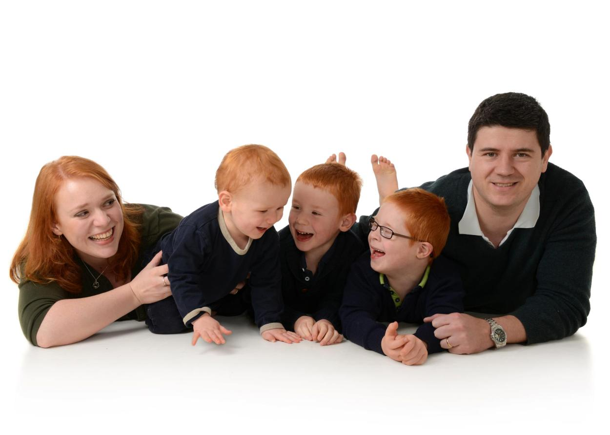 How is it possible that my children have the red hair gene expressed so dominantly? I have dark hair and my parents do so too!
